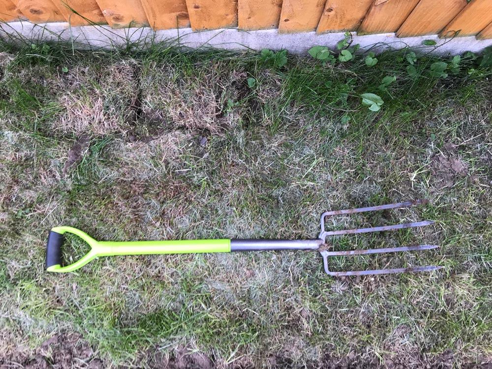 garden fork digging grass
